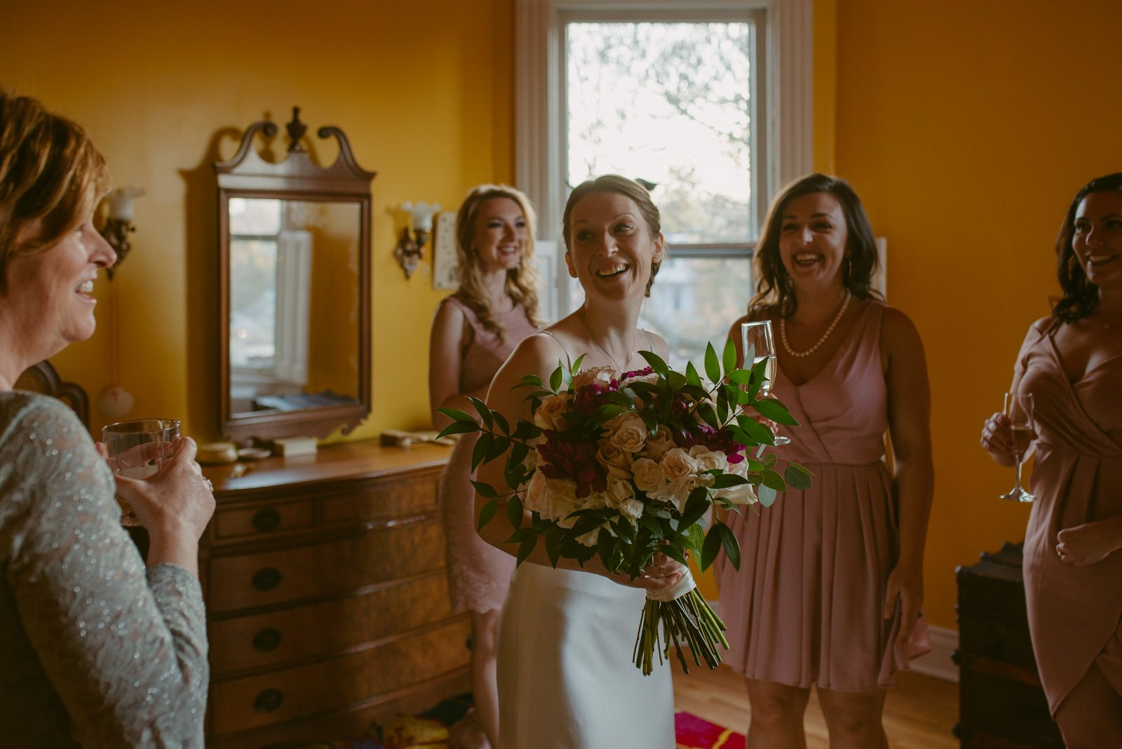 bridesmaids bride and brides mother laugh together at a tiny intimate wedding in cincinnati